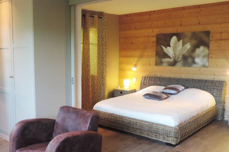 Photographie d'une chambre à coucher dans une maison de vacances à louer à Mirabel