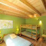 Photographie d'une chambre d'une maison de vacances